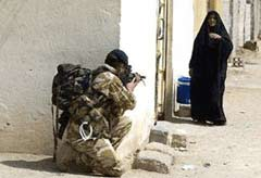 Soldier and Iraqi woman